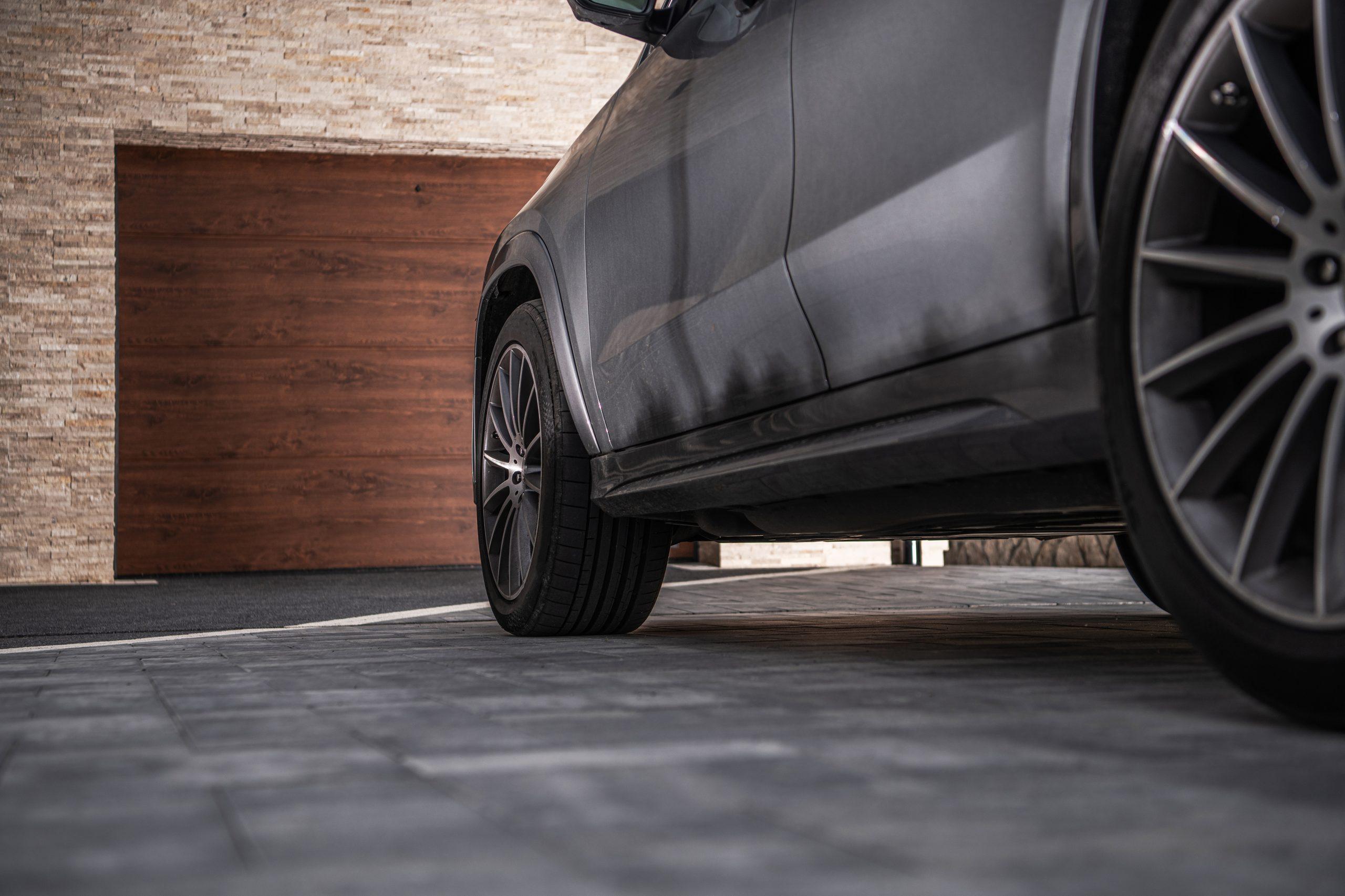 Is concrete or asphalt better for a driveway?